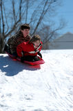 Meninos que sledding Fotos de Stock Royalty Free