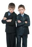 Meninos sérios de Yong no fundo branco Fotografia de Stock