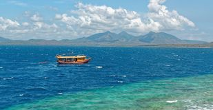 Dive boat at Menjangan Island. Menjangan Island is a small island, located 5 miles to the north-west of Bali island, is known for it`s healthy colorful reef and Royalty Free Stock Photos