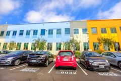 Facebook Menlo Park. Menlo Park, California, United States - August 13, 2018: Numbered seats for employees car in front of the colorful buildings of Facebook stock photography
