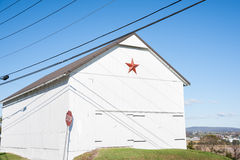 Mennonite star on white shed Stock Photography