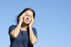 Menopausa matura sollecitata della donna Immagini Stock