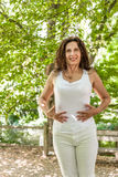 Menopausal woman has a flat belly Royalty Free Stock Images