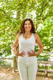 Menopausal woman has a flat belly Royalty Free Stock Photo