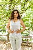 Menopausal woman has a flat belly Stock Photography