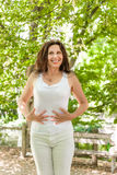 Menopausal woman has a flat belly Royalty Free Stock Photography