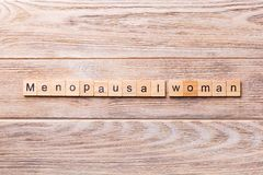 Menopausal woman word written on wood block. menopausal woman text on wooden table for your desing, concept royalty free stock photos