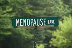 Menopause Lane Sign. Green street sign with white letters for Menopause Lane stock photography