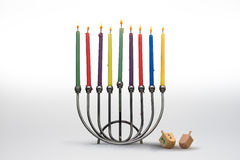 Menora and Dreidels. Hannukah Menorah with eight burning candles and two dreidels stock image
