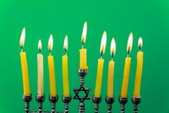 Menora of Hanuka on greenscreen. Hanukkah menorah with candles Stock Images