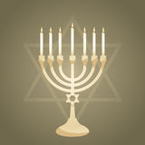 Menorah. Judah star and menorah in front of grey background Royalty Free Stock Photography