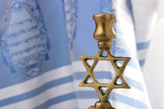 Menorah. In front of a blue and white tallit. Add your text to the background Royalty Free Stock Photography