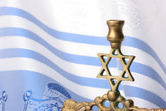 Menorah. Standing in front of a blue and white tallit. Add your text to the background Royalty Free Stock Photos