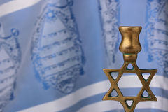 Menorah. In front of a blue and white tallit. Add your text to the background Stock Image