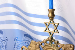 Menorah. In front of a blue and white tallit. Add your text to the background Stock Images