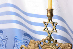 Menorah. Standing in front of a blue and white tallit. Add your text to the background Royalty Free Stock Photography