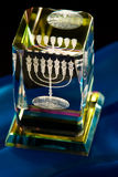 Menorah. Close-up on menorah in a crystal cube royalty free stock photo