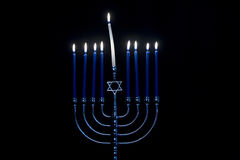 Menorah. A menorah isolated on a black background royalty free stock images