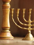 Menorah Bronze dell'oro Fotografie Stock