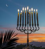 Menorah with burning candles stock photography