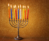 Menorah with candels and glitter lights background. hanukkah concept. Royalty Free Stock Images