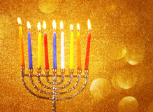 Menorah with candels and glitter lights background. hanukkah concept. Stock Image