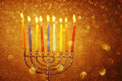 Menorah with candels and glitter lights background. hanukkah concept stock photo