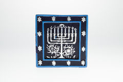 Menorah Candle. A candle with a menorah picture against a white background Royalty Free Stock Image