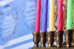 Menorah candles. In front of a blue and white tallit. Add your text to the background Stock Image