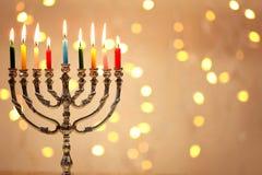 Menorah with candles for Hanukkah. Against defocused lights Royalty Free Stock Image