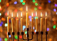Menorah with candles for Hanukkah. Against defocused lights, close up Royalty Free Stock Images