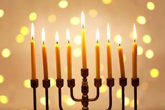 Menorah with candles for Hanukkah. Against defocused lights, close up Royalty Free Stock Photo
