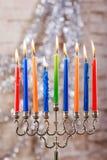 Menorah with candles for Hanukkah against defocused lights Stock Images