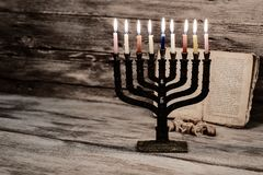 Menorah with candles for Hanukkah against defocused lights,. Close up Stock Photography