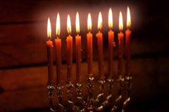 Menorah with candles for Hanukkah. On blurred wooden background, close up Royalty Free Stock Image