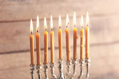 Menorah with candles for Hanukkah. On blurred wooden background, close up Royalty Free Stock Photography