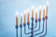 Menorah with candles for Hanukkah. On blurred wooden background, close up Stock Images