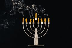 Menorah and candles for hanukkah. Hanukkah celebration with menorah and candles, isolated on black Royalty Free Stock Images