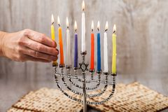 Menorah with candles for Hanukkah on a light wooden background royalty free stock photography