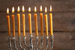 Menorah with candles for Hanukkah. On blurred wooden background, close up Stock Photo
