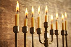 Menorah with candles for Hanukkah. On wooden background, close up Stock Photos