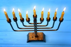 Menorah with candles for Hanukkah. On  wooden table Stock Photos