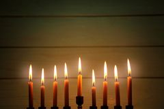 Menorah with candles for Hanukkah. On  wooden background, close up Royalty Free Stock Image
