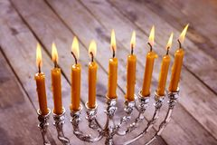 Menorah with candles for Hanukkah. On  wooden background, close up Royalty Free Stock Photo