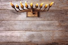 Menorah with candles for Hanukkah. On  wooden background Stock Images