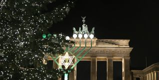 Menorah and Christmas Tree in Pariser Platz, Berlin, Germany. Menorah and Christmas Tree in front of Brandenburg Gate, Pariser Platz, Berlin, Germany Royalty Free Stock Photos