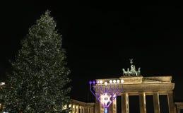 Menorah and Christmas Tree in Pariser Platz, Berlin, Germany. Menorah and Christmas Tree in front of Brandenburg Gate, Pariser Platz, Berlin, Germany Stock Photography