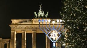 Menorah and Christmas Tree in Pariser Platz, Berlin, Germany. Menorah and Christmas Tree in front of Brandenburg Gate, Pariser Platz, Berlin, Germany Royalty Free Stock Image