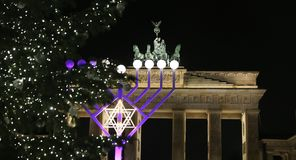 Menorah and Christmas Tree in Pariser Platz, Berlin, Germany. Menorah and Christmas Tree in front of Brandenburg Gate, Pariser Platz, Berlin, Germany Royalty Free Stock Images