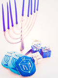 Menorah. Contemporary menorah with blue candels on white background Royalty Free Stock Images